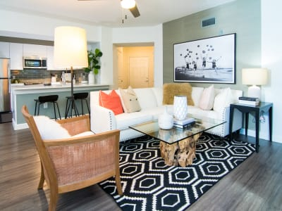 Model living room and kitchen at The Sophia at Abacoa in Jupiter, Florida