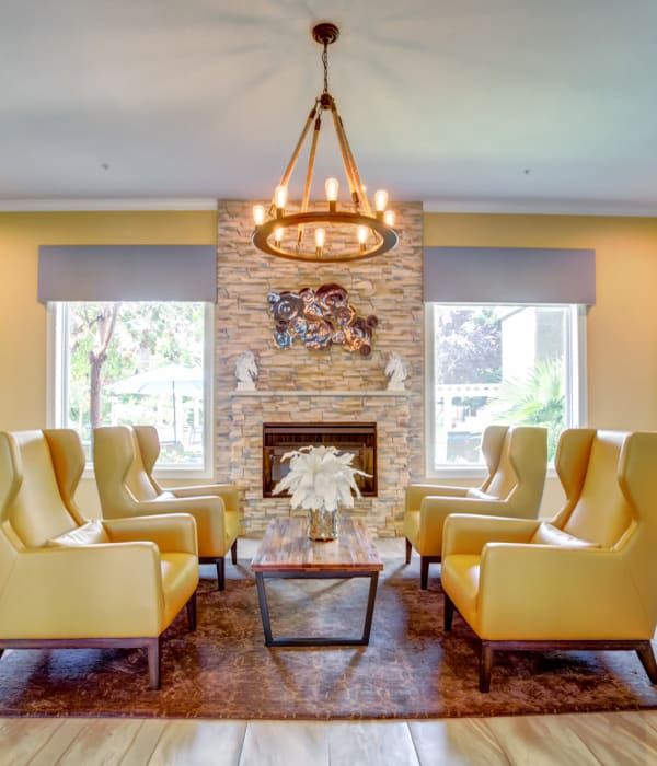 Clubhouse lounge and fireplace at Hawthorn Village Apartments in Napa