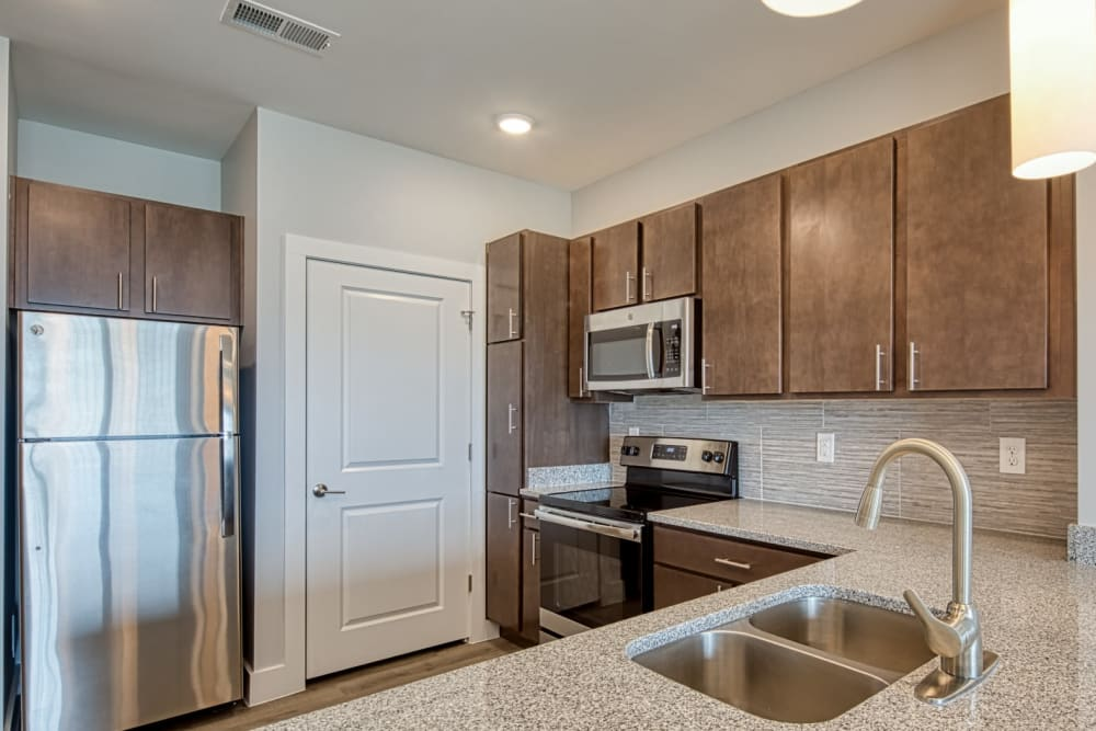 An open kitchen with lots of natural lighting at Marina Villa in Norfolk, Virginia