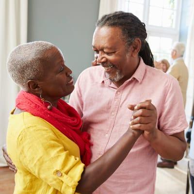 Two residents dancing at Arbor Glen Senior Living in Lake Elmo, Minnesota