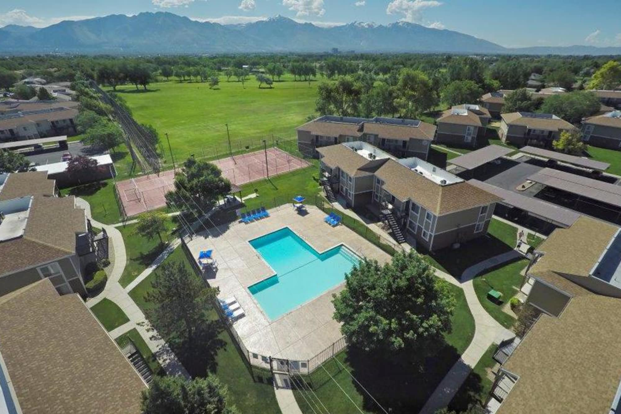 aerial view of property and surrounding area including a golf course next door at Callaway Apartments in Taylorsville, UT