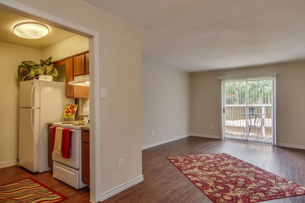 Apartment interior with wood-style flooring at Cambridge Place in Houston, Texas