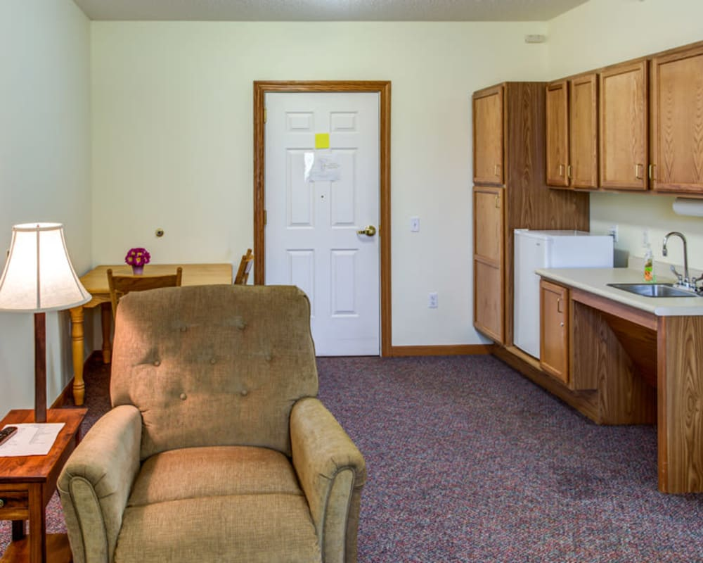 Resident apartment with a kitchenette at Prairie Hills in Tipton, Iowa.