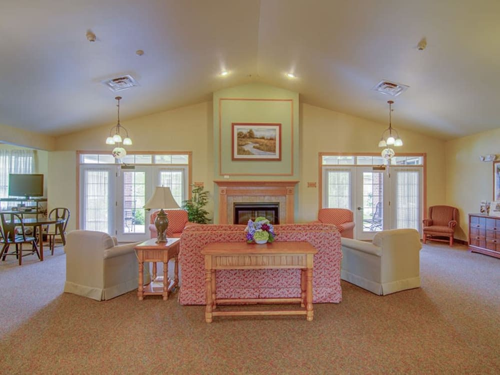 Resident community area with vaulted ceilings and large windows at Randall Residence of McHenry in McHenry, Illinois