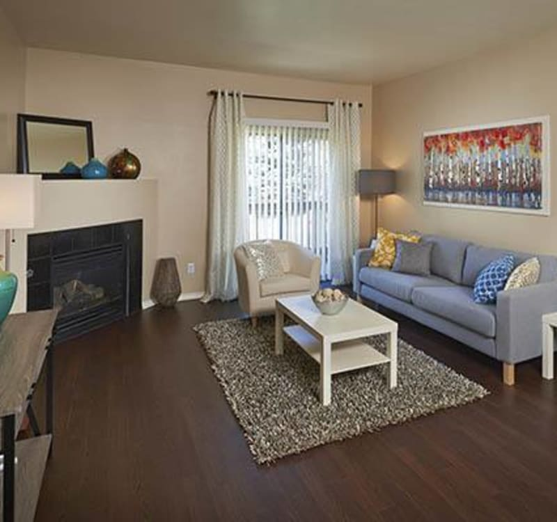 living room with fireplace at Crossroads at City Center Apartments in Aurora,