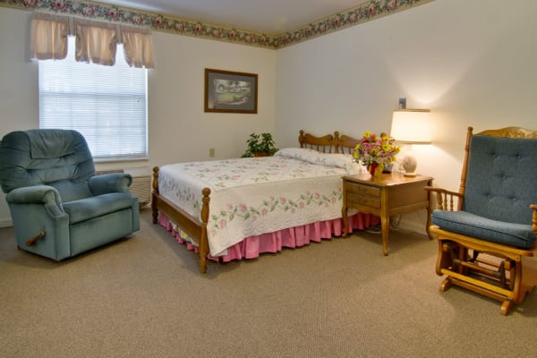 Assisted living apartment bedroom at NorthPark Village in Ozark, Missouri
