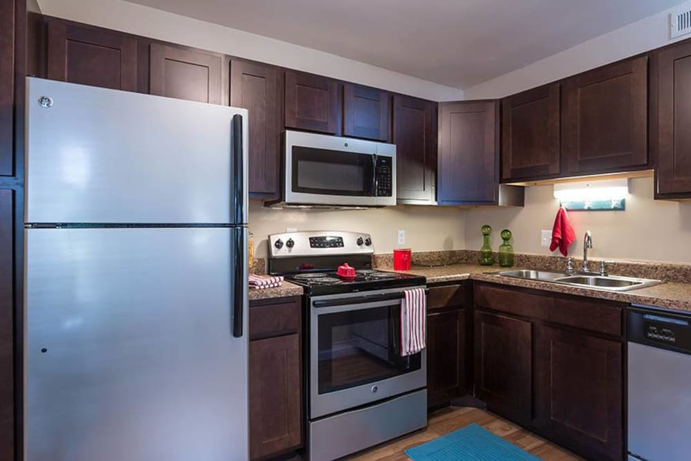 A modern kitchen with stainless-steel appliances at Sunbrook Apartments in Saint Charles, Missouri
