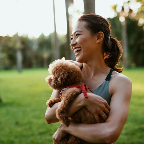 A lady and her pet at a dog park near Haven Hills in Vancouver, Washington