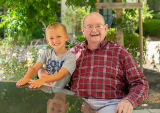 Happy resident and grandson at senior living in Mount Pleasant