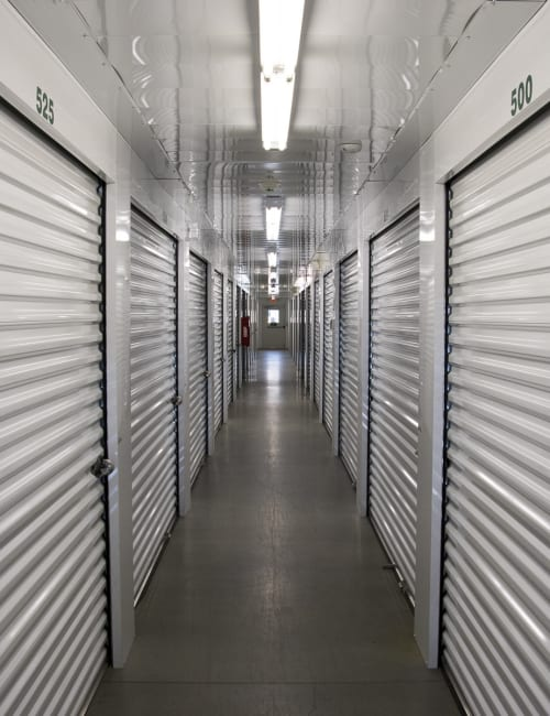 An inside hallway of storage units at Storage World in Sinking Spring, Pennsylvania