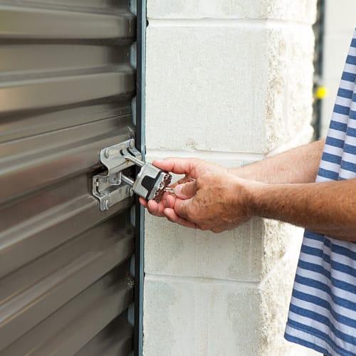 A man unlocking his unit at a San Diego Self Storage location
