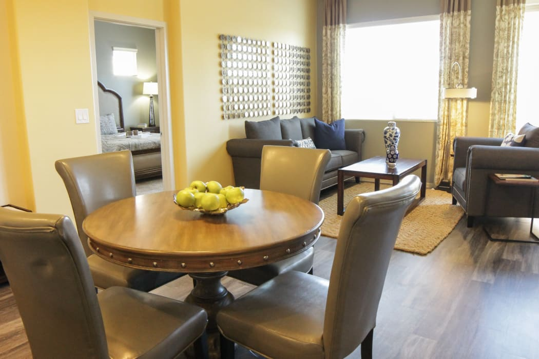 Dining room and spacious living room at Avilla Town Square in Gilbert, Arizona