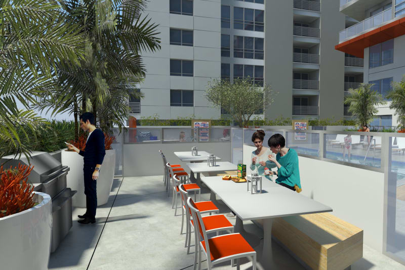 Pool deck with BBQ area at 1400 Fig in Los Angeles, California