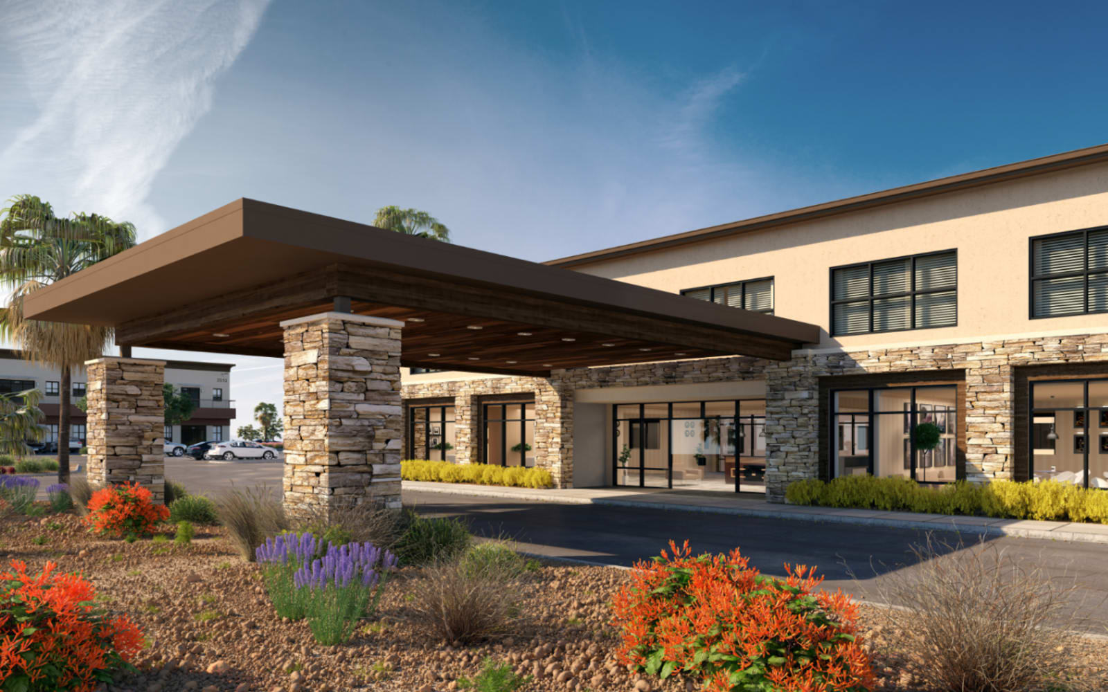 A rendering of the parking lot and main entrance at Carnegie Heights at Henderson in Henderson, Nevada