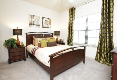 Bedroom in model home at Evolv in Mansfield, Texas