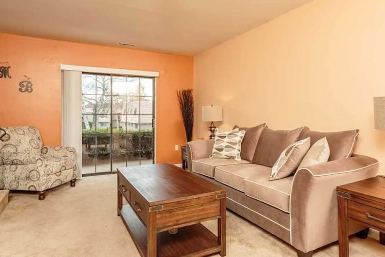 Enjoy family time in your living room at Meadowbrook Apartments in Slingerlands, NY