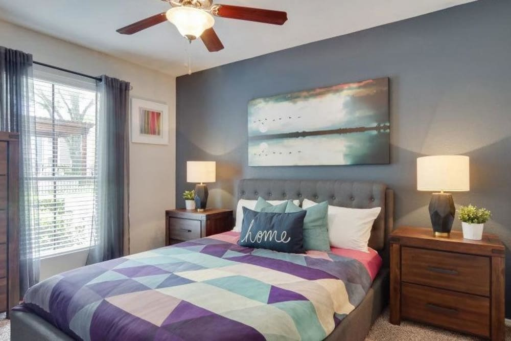 Well lit model bedroom decorated in model home at Vantage Point in Houston, Texas