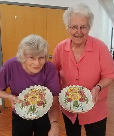 Residents showing off their creations from craft class at Garden Place Waterloo in Waterloo, Illinois.