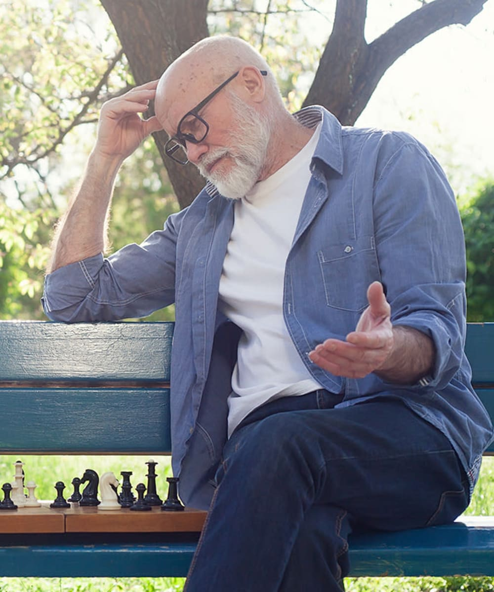 Senior playing chess in the park at Estancia Del Sol in Corona, California