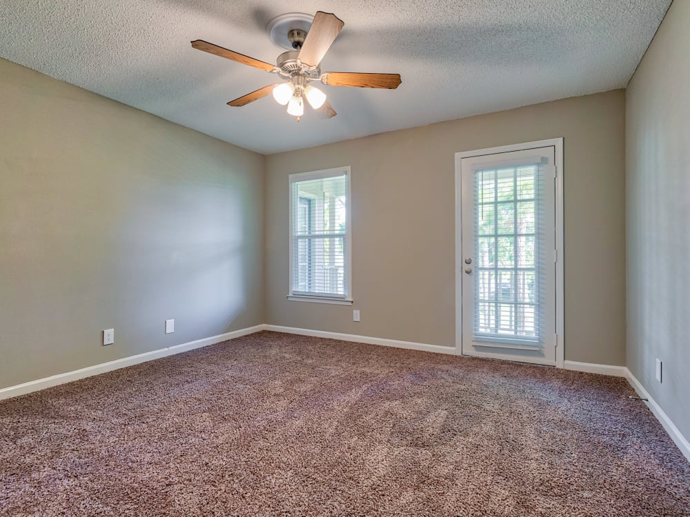 bedroom with ceiling fan at The Gatsby at Midtown Apartment Living in Montgomery, AL
