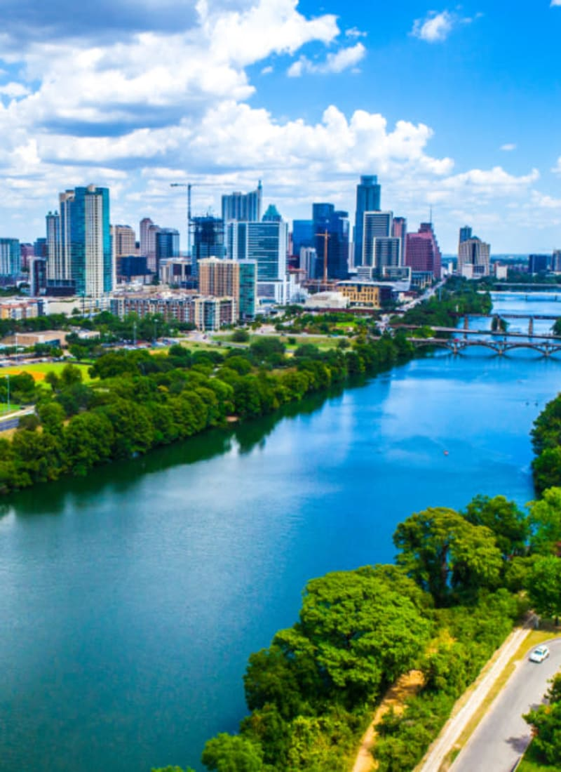 Skyline view of downtown along river in Austin, Texas from Marquis at Barton Trails