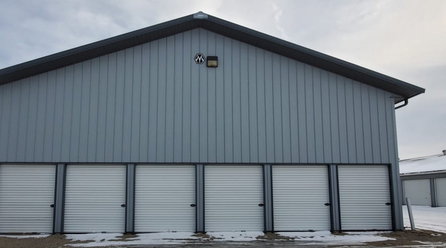 Storage units with white doors and locks at KO Storage of Waseca 5th St in Waseca, Minnesota