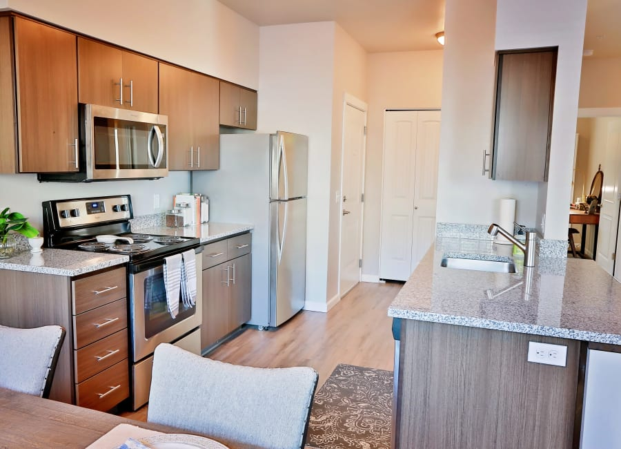 apartment kitchen with granite counter top The Boulevard in Philomath, Oregon