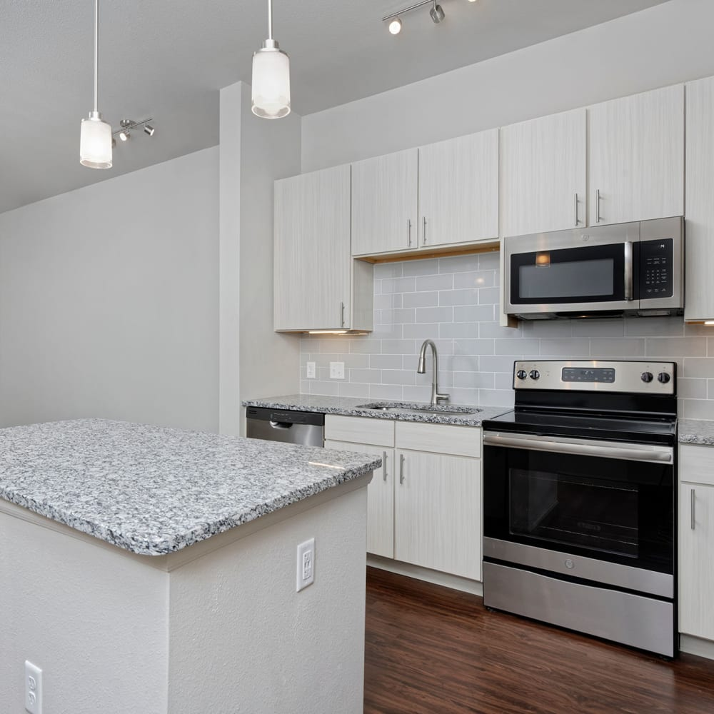 Kitchen with island at Civic Lofts | Luxury Apartments in Denver, Colorado
