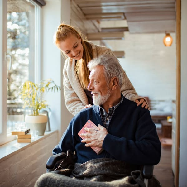 A caregiver attending to a resident at The Crest at Citrus Heights in Citrus Heights, California