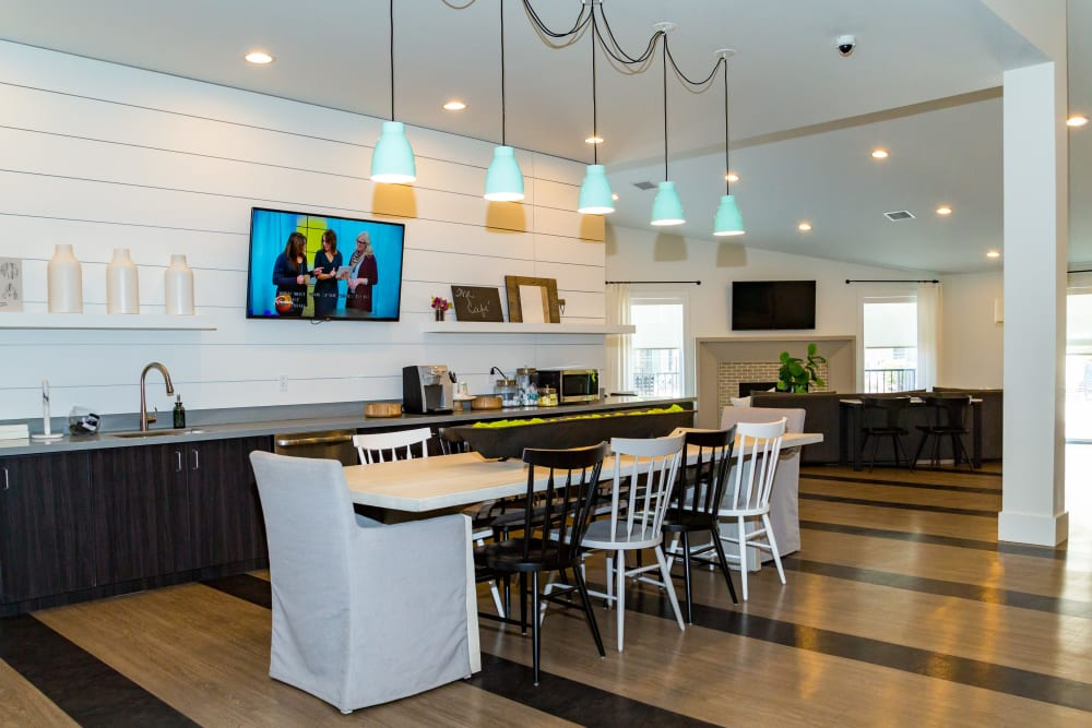 A community  kitchen with bar seating at Metro on 5th in Saint Charles, Missouri