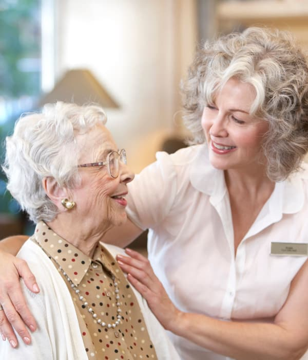 Nurse helping a Mason Assisted Living & Memory Care resident