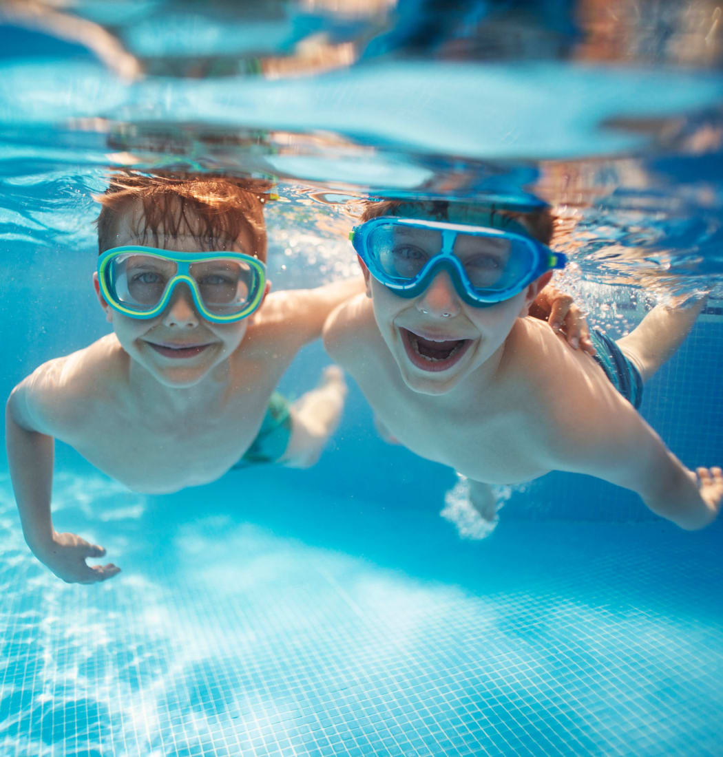 Kids swimming in the pool at IMT Park Encino in Encino, California