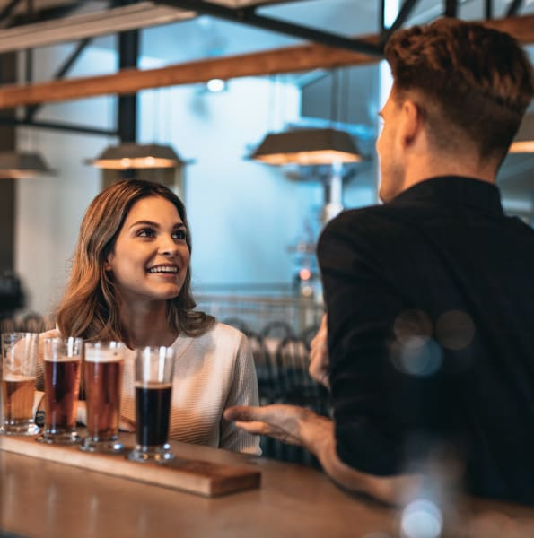 Friends enjoying drinks at a local bar near Linden Pointe in Pompano Beach, Florida