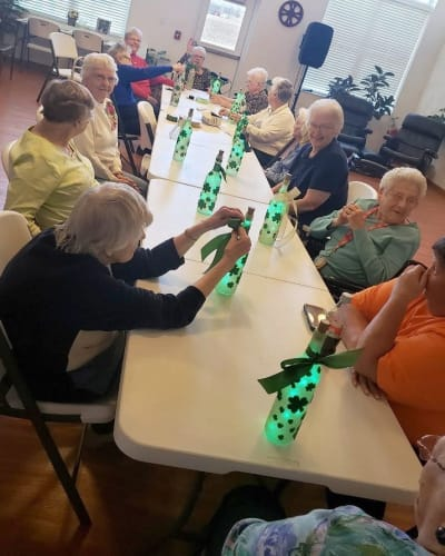Residents making crafts out of bottles at Garden Place Waterloo in Waterloo, Illinois.