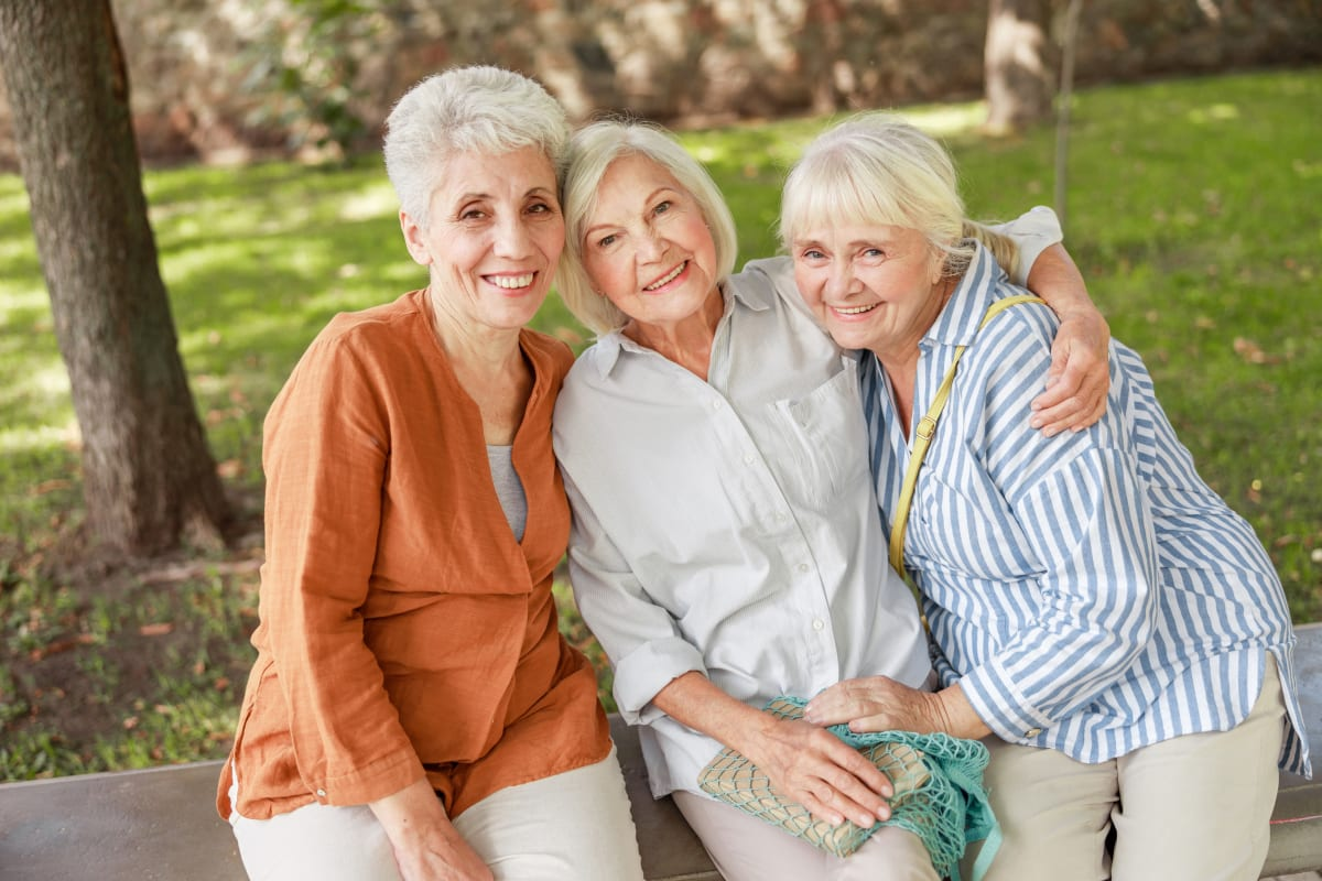 Three Women outside smiling