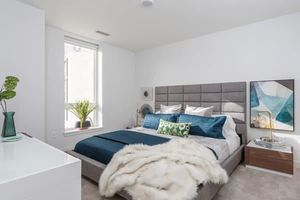 Cozy bedroom at 50 Front Luxury Apartments in Binghamton, New York