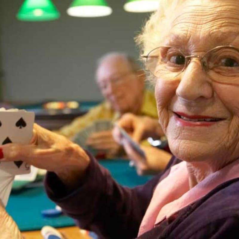 Seniors playing cards at Peninsula Reflections in Colma, California