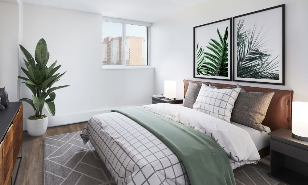 Tastefully decorated model bedroom at Richmond Hill Apartments in Richmond Hill, Ontario