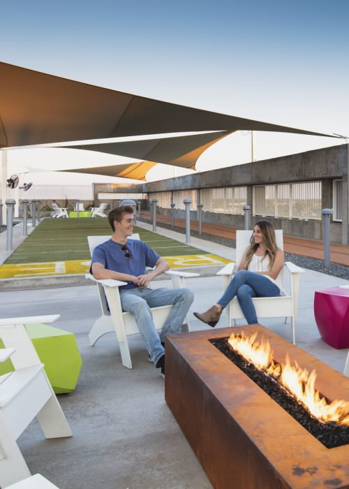 Outdoor lounge with a fireplace at RISE on Apache in Tempe, Arizona