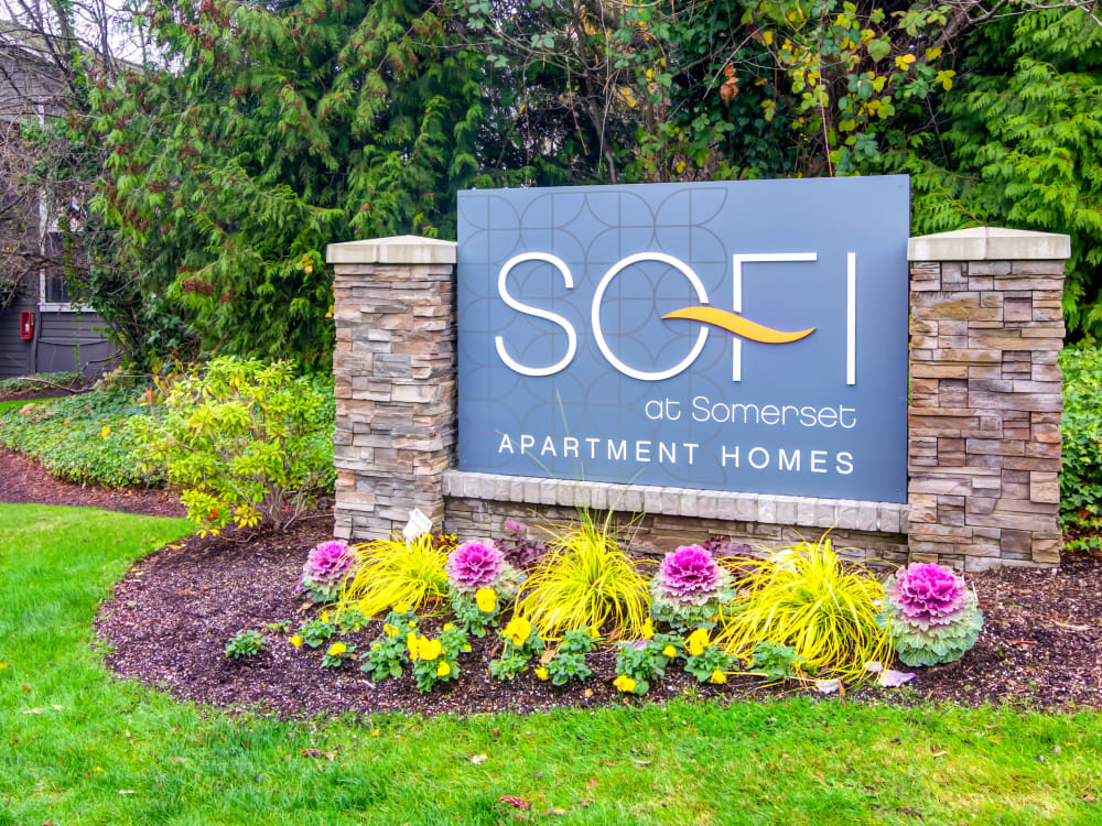 Our monument sign surrounded by flowers at Sofi at Somerset in Bellevue, Washington