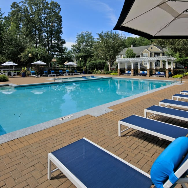 Beautiful sophisticated swimming pool and lounge area at Cavalier @ 100 in Lithonia, Georgia