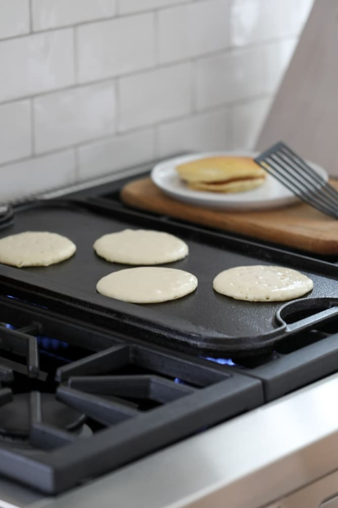 Pancakes cooking on a flat top at Solana Stapleton Apartments in Denver, Colorado