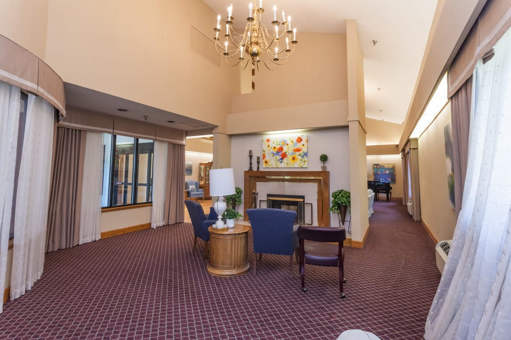 Area to relax in front of fireplace at River Commons Senior Living in Redding, California