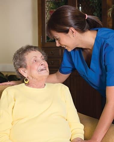 Caregiver at Burr Ridge Senior Living chatting with resident
