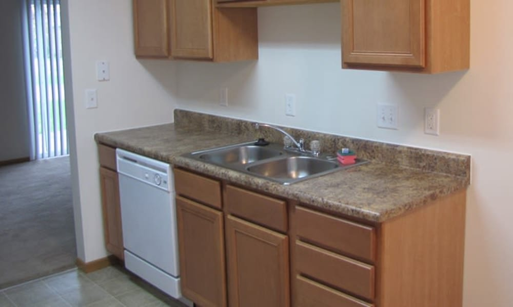 Kitchen with dishwasher at Indian Footprints Apartments in Harrison, Ohio