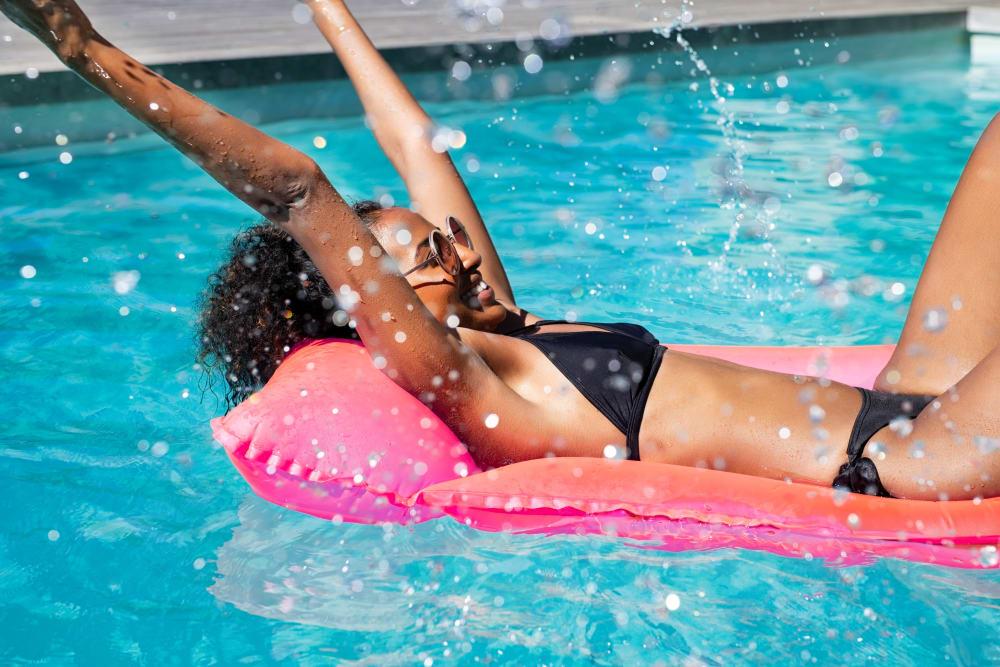Resident floating in the swimming pool at Ellington Midtown in Atlanta, Georgia