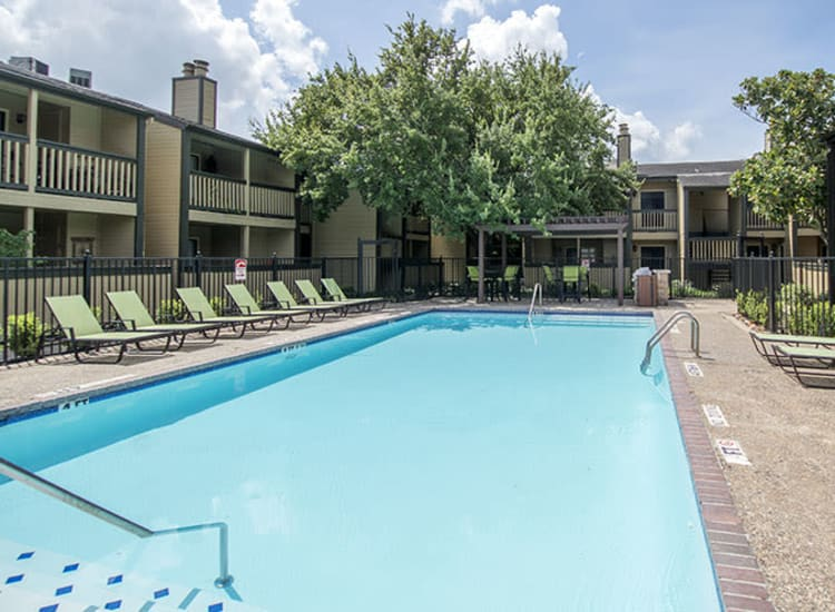 Resident pool with lounge chairs at Stonecrossing of Westchase in Houston, Texas.