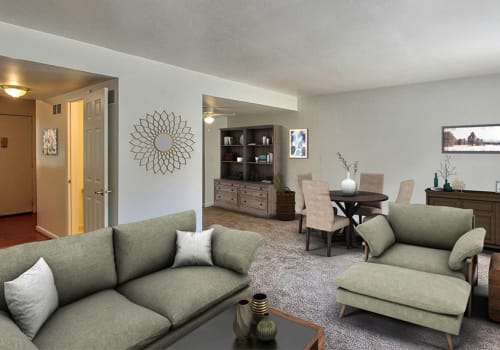 Spacious living room at Elmwood Terrace Apartments & Townhomes in Rochester, New York