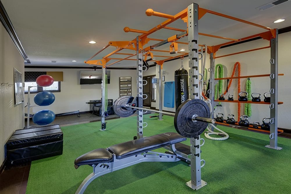Workout at the fitness center at Integra Hills Preserve Apartments in Ooltewah, TN