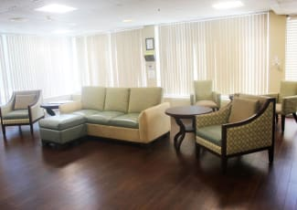 A large, comfortable seating area at Village Place Senior Living in Port Charlotte, Florida